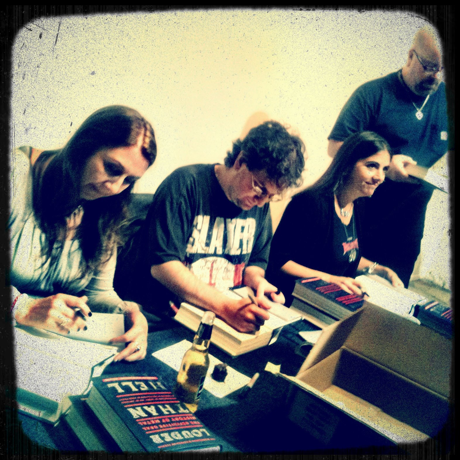 With authors Katherine Turman and Jon Wiederhorn and photographer Stephanie Cabral signing copies of Louder Than Hell at the book launch at PowerHouse Arena in Brooklyn, NY- May 13, 2013. Photo by Shawn Williams