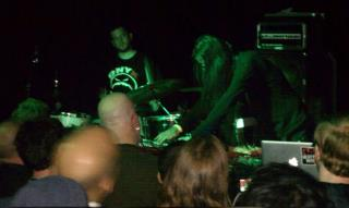 greg C (left of center) photographing Merzbow at Saint Vitus Bar in Brooklyn, NY- June 4, 2012. Photo by Nick McMaster.